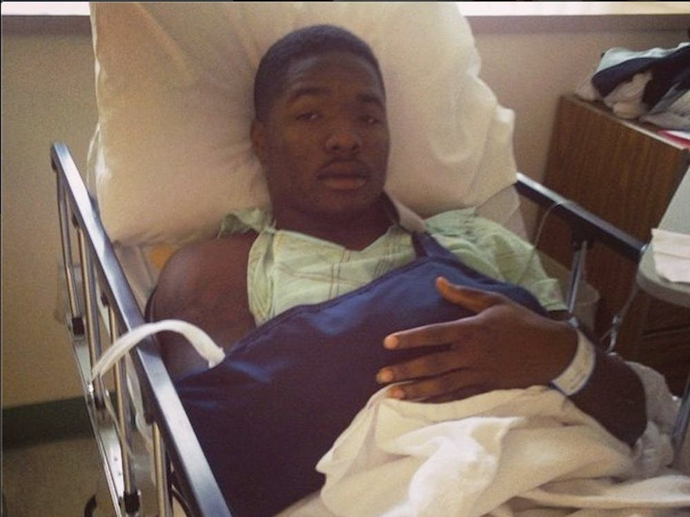 """Eric Patterson, a senior cornerback, posted this photo on Instagram with the caption, """"Surgery went great I'll be back n no time! Thanks to everyone who supported me thru this tough time.. Lift will be back #NFL2015 watch out."""" Patterson broke his arm during the game against Northern Illinois on Nov. 5 at Scheumann Stadium.PHOTO COURTESY OF INSTAGRAM"""