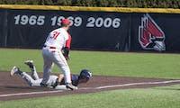 Ball State Baseball's John Ricotta tags a Dayton player during the game against the Flyers March 18, 2018, at Ball Diamond at First Merchant's Ballpark Complex. The opposing player was called out. Briana Hale, DN