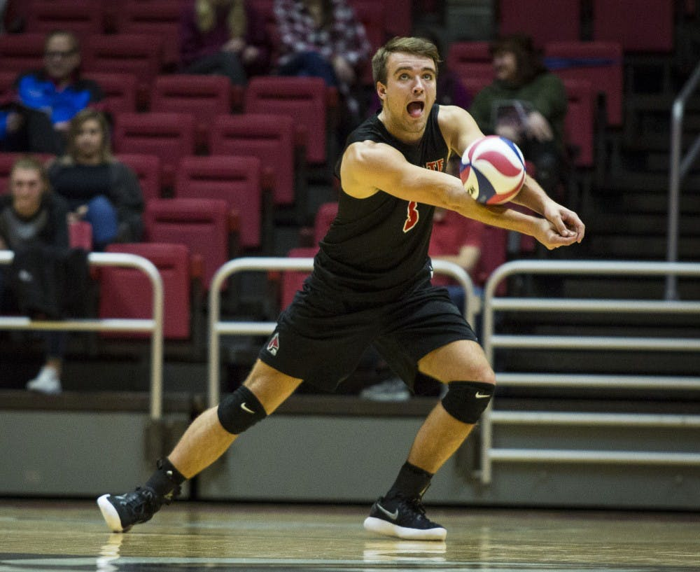 <p>Sophomore outside hitter Blake Reardon, receives a serve from a Harvard Crimson player during the beginning of the third set, Jan. 20 at John E. Worthen Area. Ball State defeated Harvard, 25-22, 23-25, 25-21, 25-9. <strong>Grace Hollars, DN</strong></p>