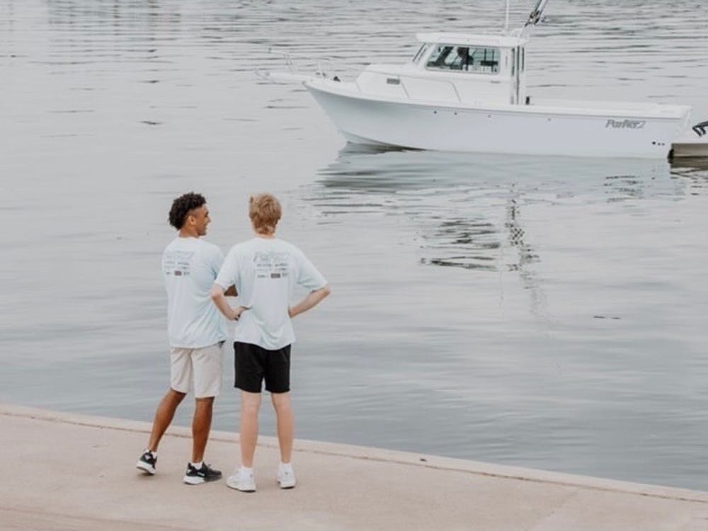 """Eddie Gill IV (left) and Justin Shupe (right) stand at Dress Plaza in Evansville, Indiana on the morning of their sendoff for """"Journey for a Cause."""" The trip concluded June 10 at Juana's Pagodas in Navarre, Florida. Eddie Gill IV, Photo Provided"""
