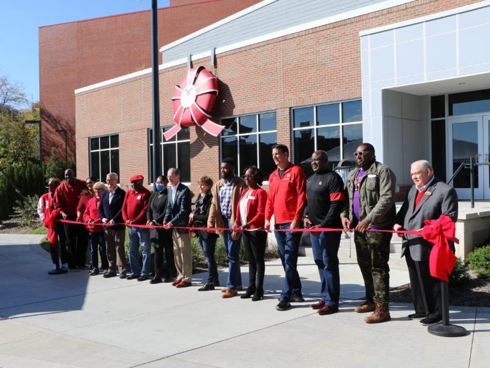 Members of the Ball State community, including President Geoffrey Mearns, get ready to cut the ribbon at the Multicultural Center Oct. 23. The new Multicultural Center is located next to Bracken Library. Shwetha Sundarrajan, DN