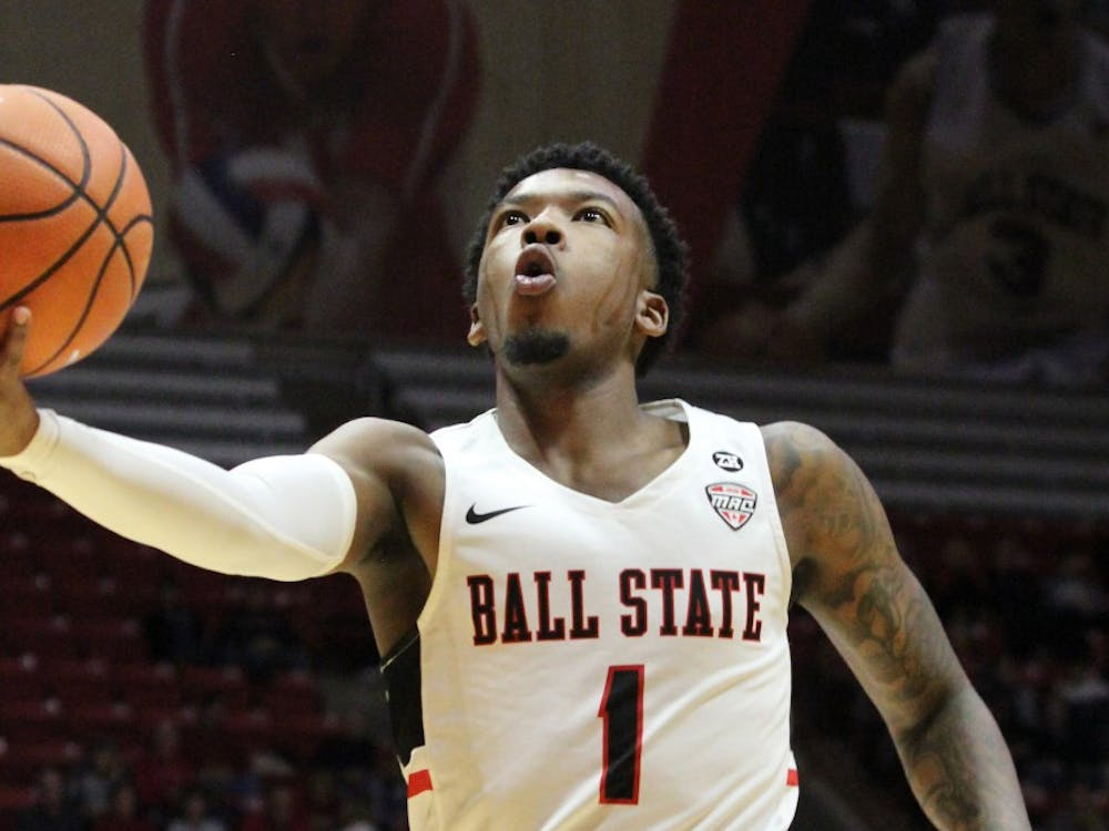 Junior guard Jontrell Walker shoots a layup in the second half of Ball State's game against Stony Brook on Nov. 17 in John E. Worthen Arena. Walker scored eight points. Paige Grider, DN