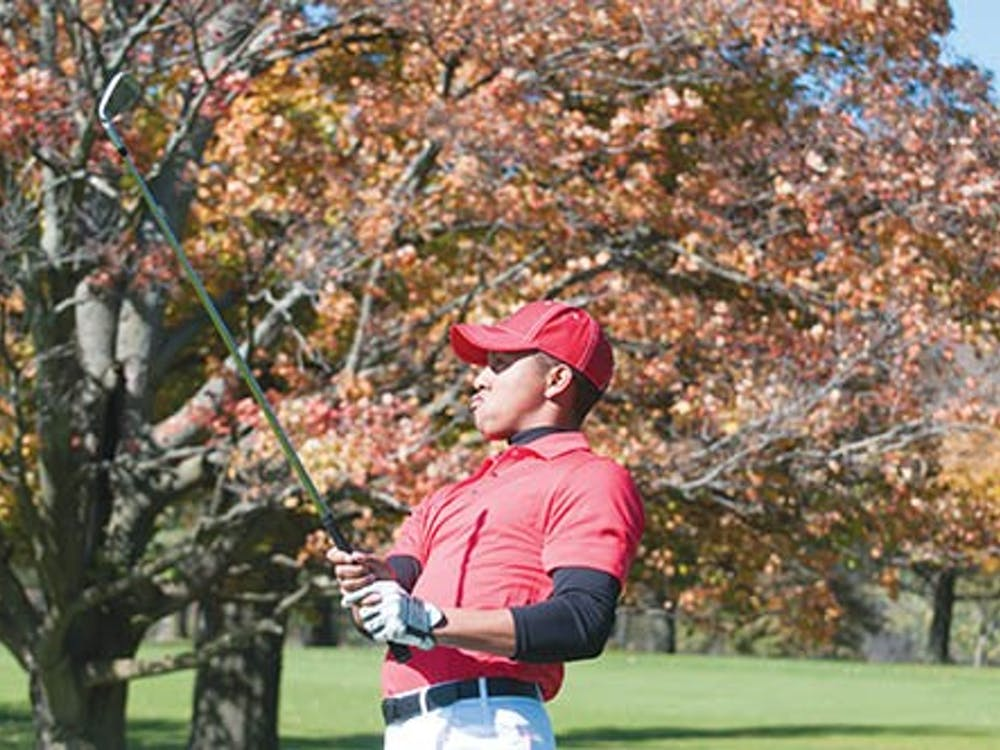 James Blackwell takes his shot at the Delaware Country Club in Muncie, during the Earl Yestingsmeier Invitational on Oct. 16.  The men