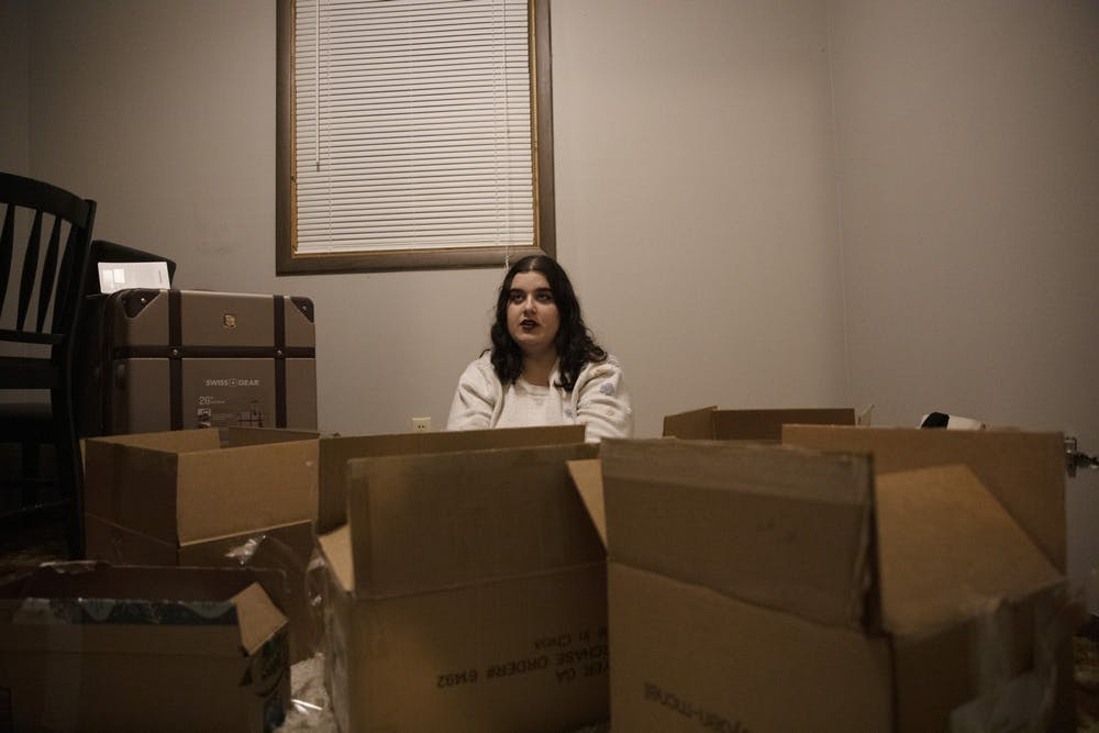 <p>Elena Stidham sits in her apartment surrounded by boxes Feb. 25, 2020, in Muncie, Indiana. Stidham recently moved to her new apartment after leaving her last apartment. <strong>Jacob Musselman, DN</strong></p>
