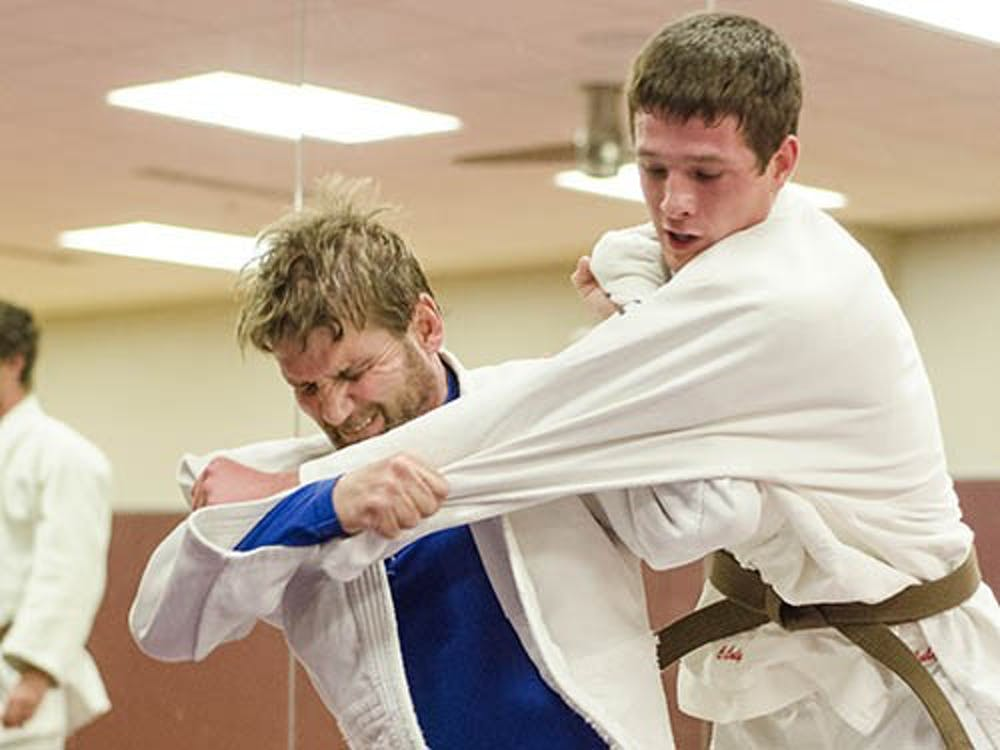 Guest instructor Brad Daniels throws student and club member Caleb Culy in an exercise called Nage komi, an exercise on repeated throws. Two novice members earned third place in the Women's Novice Team category at the National Collegiate Judo Tournament in Iowa over the weekend. DN PHOTO COREY OHLENKAMP