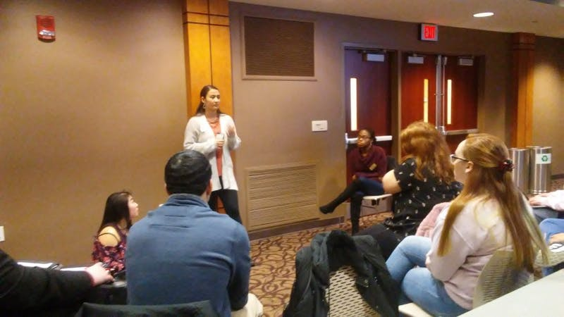 On-Campus Chair Miryam Bevelle speaks to her caucus during a five minute meeting at the Student Government Association (SGA) meeting Wednesday, Feb. 13, 2019, in the L.A. Pittenger Student Center. SGA intends on automatically signing up all members of the Ball State community for the university's emergency text alert system. Charles Melton, DN
