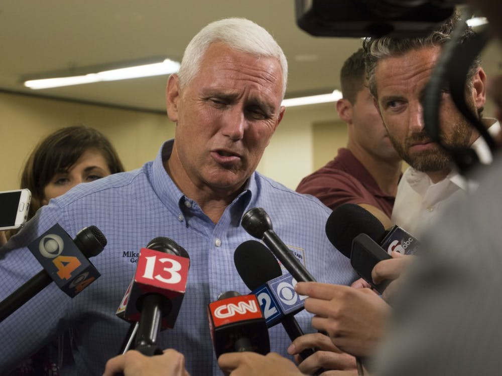 Indiana Governor Mike Pence visited the Delaware County Fairgrounds on July 13 to host an agricultural roundtable discussion with community leaders. With Pence in contention to become presidential candidate Donald Trump's running mate, reporters nearly outnumbered attendees in the Heartland Hall Meeting Room. DN PHOTO SAMANTHA BRAMMER