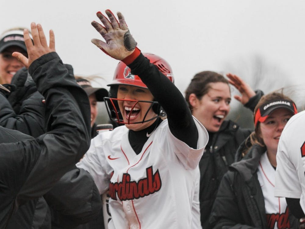 Freshman Katie Janiga high fives her teammates in celebrating the last hit during the game. The Ball State Cardinals won against Kent State with a score of 15-7 at the Softball Field at First Merchants Ballpark Complex on April 6. Carlee Ellison, DN