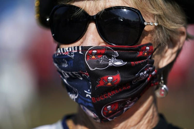 A Tampa Bay Buccaneers fans arrives before the NFL Super Bowl 55 football game between the Kansas City Chiefs and Tampa Bay Buccaneers, Sunday, Feb. 7, 2021, in Tampa, Fla. (AP Photo/Mark Humphrey)