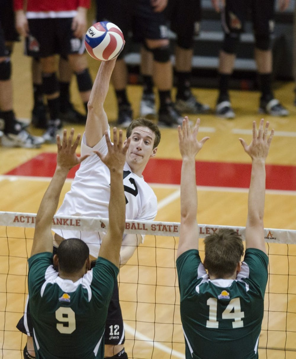 Senior outside attacker Matt Sutherland hits the ball over the net in the match against Mount Olive on March 1 at Worthen Arena. The men's volleyball team is 10-5 in their season. DN PHOTO BREANNA DAUGHERTY