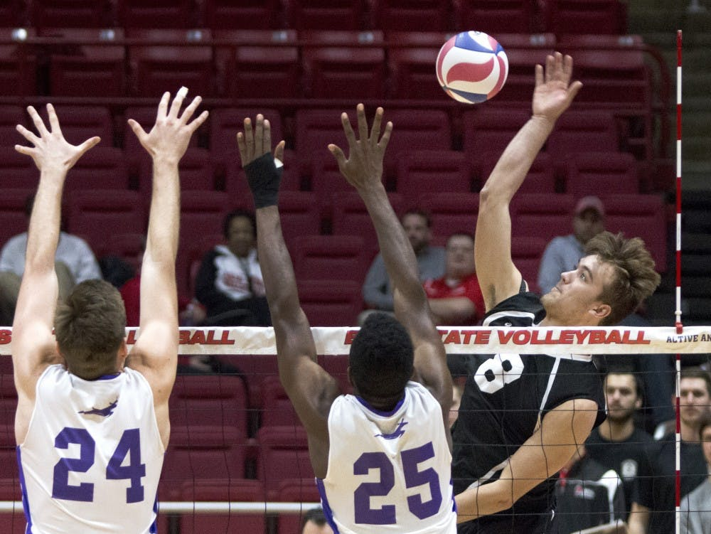Outside attacker, Blake Reardon kills the ball past Grand Canyon blockers Matthew Kinnebrew and Drake Silbernagel at Worthen Arena, March 2. Ball State lost to Grand Canyon over a stretched out 5 set match. (Grace Hollars // DN)