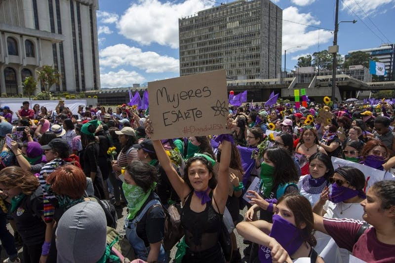 Women march in front of the Supreme Court during International Women's Day March 8, 2020, in Guatemala City. (AP Photo/Moises Castillo)