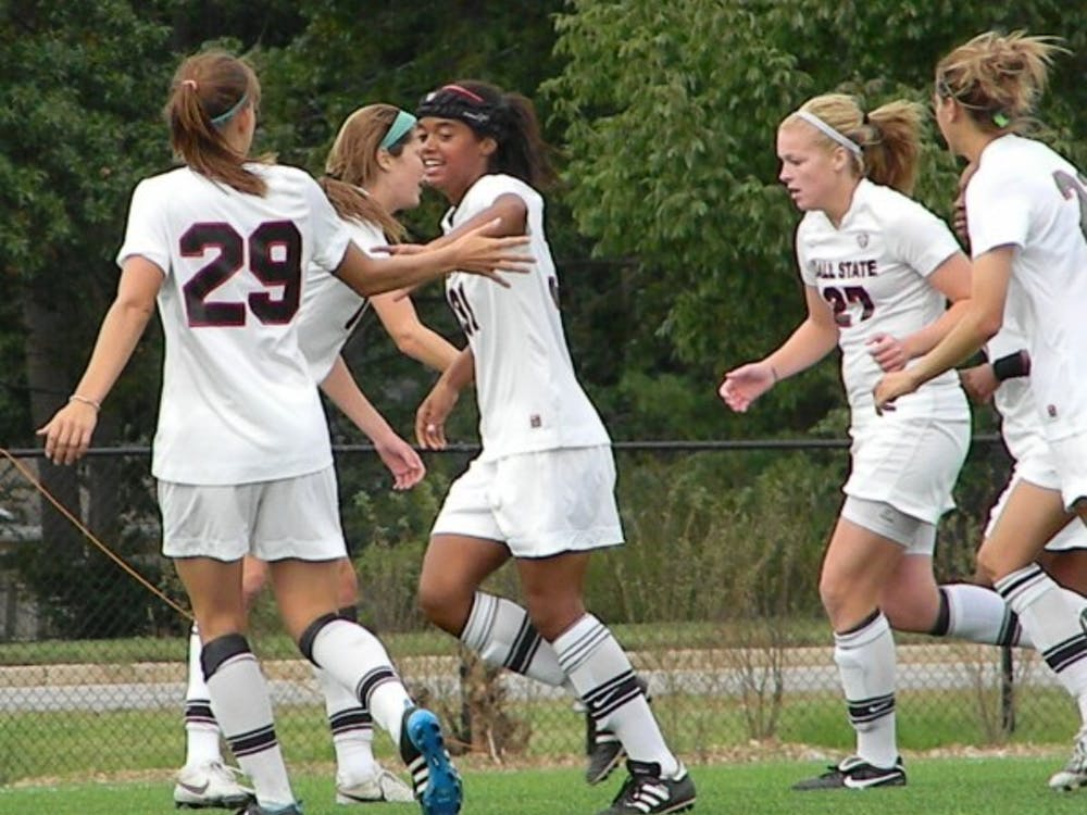 Freshman Jasmine Moses celebrates with friends after scoring a goal late in the game against Marshall. DN PHOTO SHAE GIST