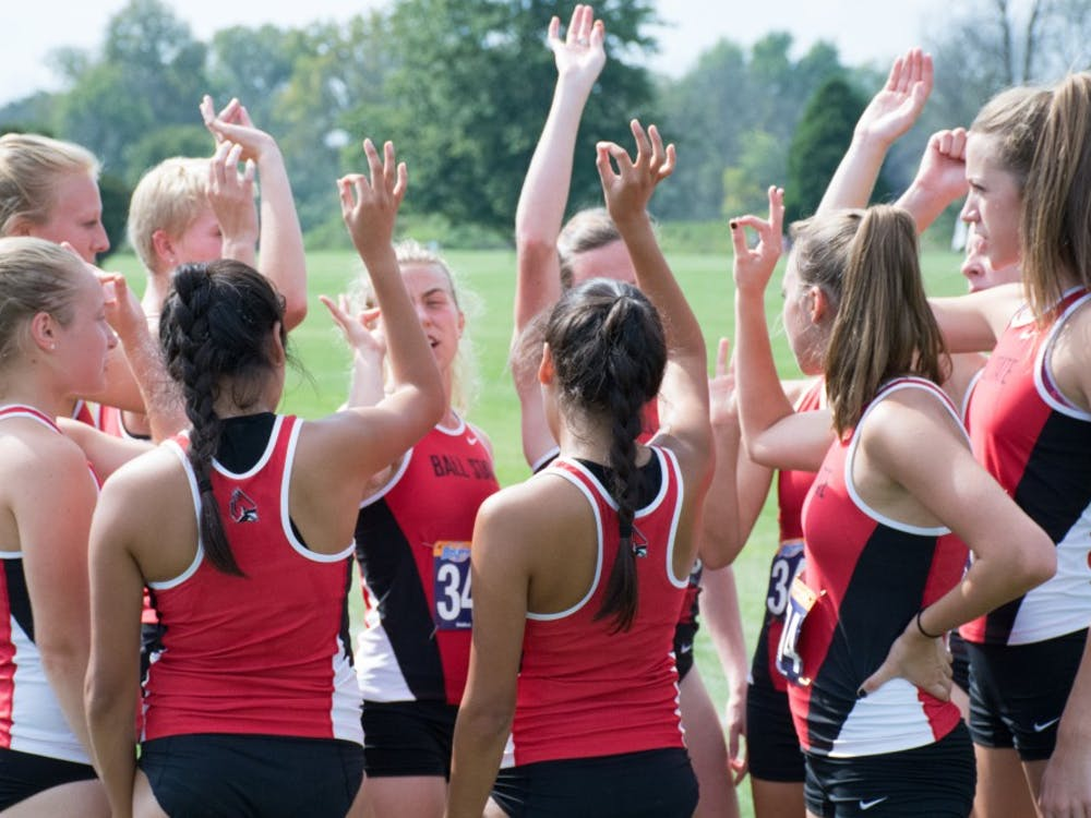The Ball State cross country team chirps  before the meet begins against IUPUI on Sept. 23, 2016 at the Muncie Elks Country Club.  Ball State won against IUPUI 16-46. Kaiti Sullivan // DN