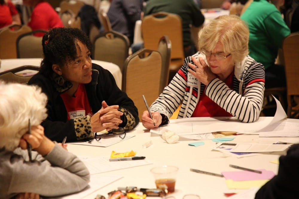 "Rep. Sue Errington (D-Muncie) fills out a sheet of paper after those at her table discussed what they want for the future of children at Muncie Community Schools at the ""Dreams for Our Schools"" event May 21, 2019, in Minnetrista. The notes taken at the event will then inform decisions being made for the academic innovation plan. Rohith Rao, DN"