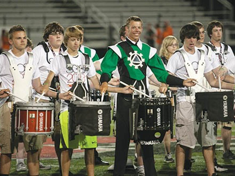 Members of the Music For All drumline perform with drummers from The Cavaliers. They arranged their piece specifically for this event. DN PHOTO JORDAN HUFFER