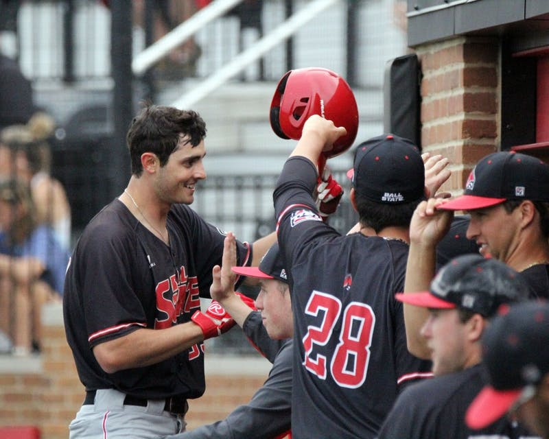 Senior center fielder Matt Eppers celebrates a triple in the eigth during the Cardinals' game against Bowling Green on April 14 at Ball Diamond at First Merchants Ballpark Complex. Eppers hit scored a runner and put Ball State up 6 to 4. Paige Grider // DN