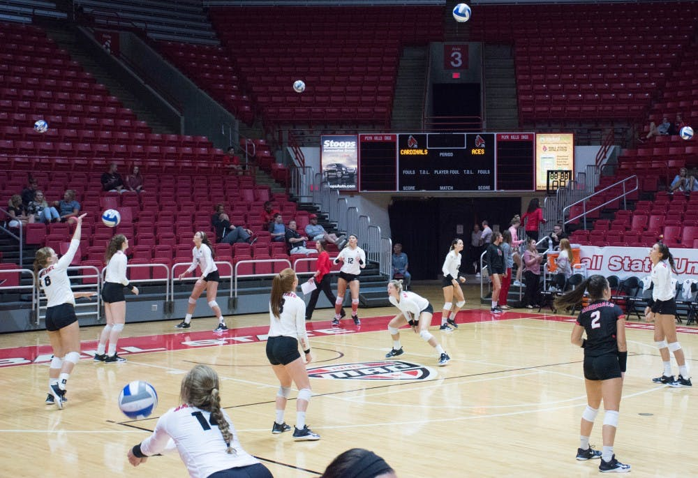 Ball State's womens volleyball team warms up after half time at the game against Evansville on Sept. 14 in John E. Worthen Arena. The Cardinals were 2-0 after halftime. Jada Coleman, DN