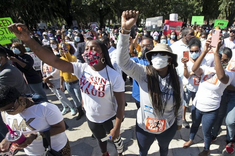 People react during a rally to protest the shooting of Ahmaud Arbery, May 8, 2020, in Brunswick Ga. Two men have been charged with murder in the February shooting death of Arbery, a black man in his mid-20s, whom they had pursued in a truck after spotting him running in their neighborhood. (AP Photo/John Bazemore)
