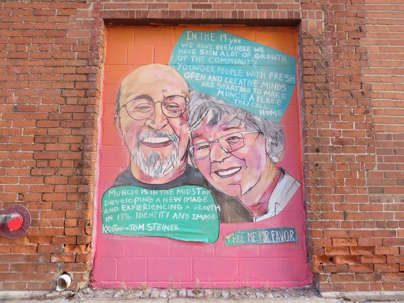 A mural in Downtown Muncie shows a man and woman discussing their love for Muncie. Blake Williamson, DN.