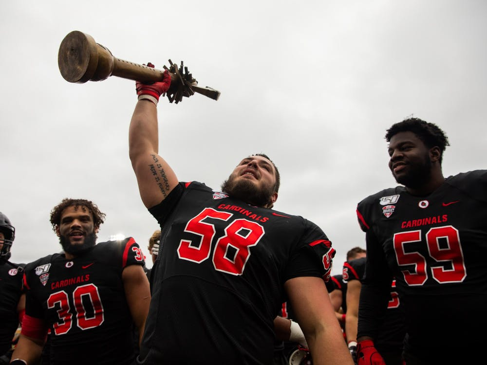 Senior defensive tackle Chris Crumb holds up the Red Bird Rivalry Trophy after beating Miami (Ohio) Nov. 29, 2019, at Scheumann Stadium. The Cardinals beat the Red Hawks, 41-27. Jacob Musselman, DN