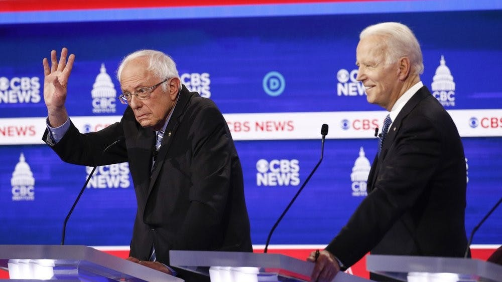 Democratic presidential candidates, Sen. Bernie Sanders, I-Vt., left, and former Vice President Joe Biden, right, participate in a Democratic presidential primary debate at the Gaillard Center, Tuesday, Feb. 25, 2020, in Charleston, S.C., co-hosted by CBS News and the Congressional Black Caucus Institute. (AP Photo/Patrick Semansky)