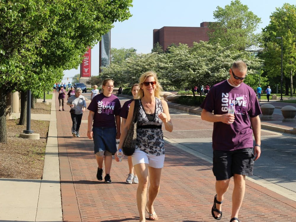 """Participants in First Choice's """"Walk for Life"""" event May 18, 2019, walk down McKinley Avenue. The event helped raise funds for pregnancy care provided by First Choice. Britney S. Kendrick, DN"""