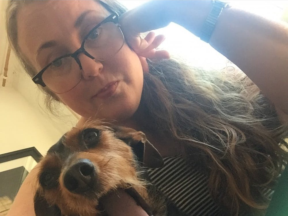 Journalism professor Colleen Steffen and her dog, Smokey.Steffen and her family rescued Smokey from the Animal Rescue Fund about two years ago.Photo Provided // Colleen Steffen