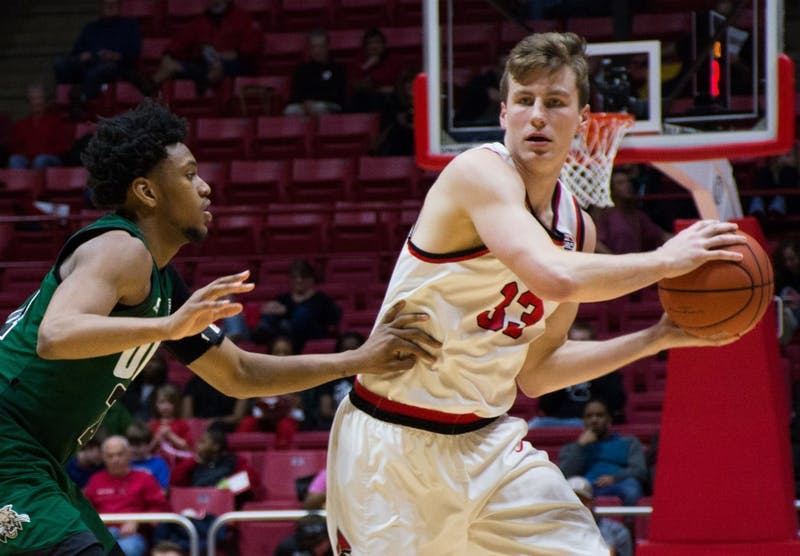 Senior forward Ryan Weber looks for a teammate to pass the ball to at the game against Ohio on Feb. 10 in Worthen Arena. Weber scored 11 points during the game against the Bobcats. Kaiti Sullivan // DN