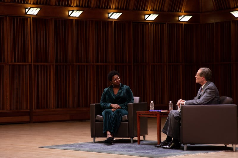 """Ashley Ford, author of """"Somebody's Daughter,"""" listens to Ball State President Geoffrey Mearns in Sursa Performance Hall Oct. 7. Ford took part in Ball State's Writer-in-Residence program which has prominent Ball State alumni return to campus to speak about their work. Eli Houser, DN"""