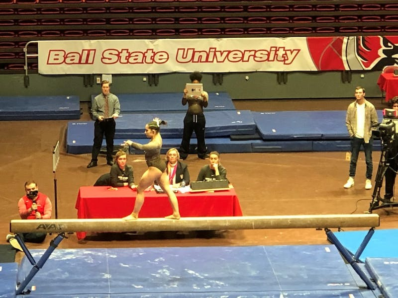 Senior Kaitlyn Menzione participates in the beam event in Worthen Arena Feb. 17, 2019, against Northern Illinois. The Cardinals fell to the Huskies, 195.700-194.700. Drew Pierce, DN