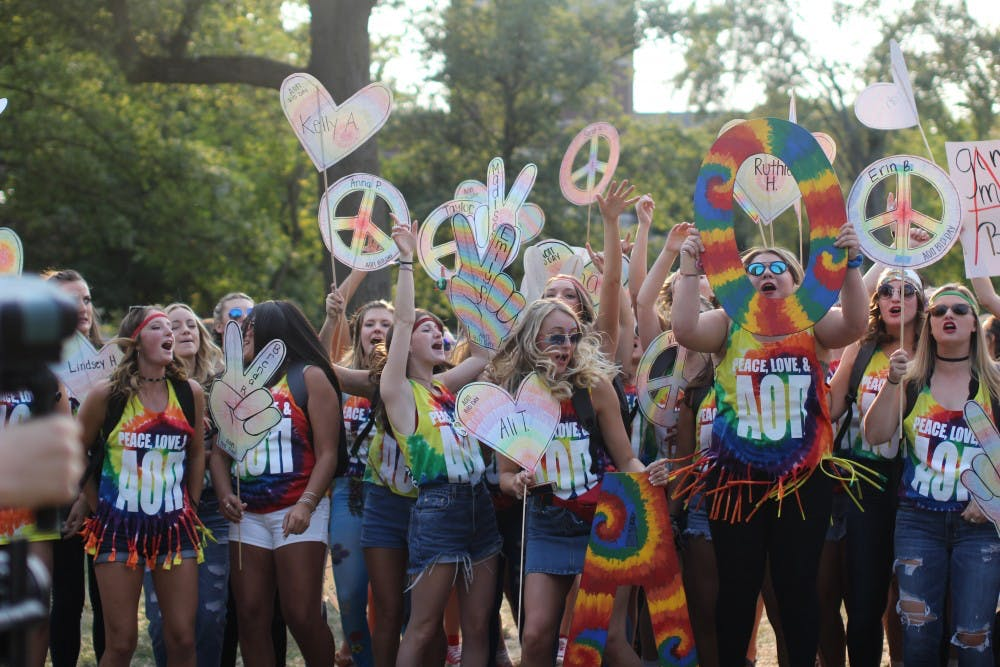 A group of Alpha Omicron Pis cheer together during Bid Day on the Quad on Sept. 10. Bid Day is where sororities accept their pledges and reunite with their Phi Chis. Cassidy Knowling, DN