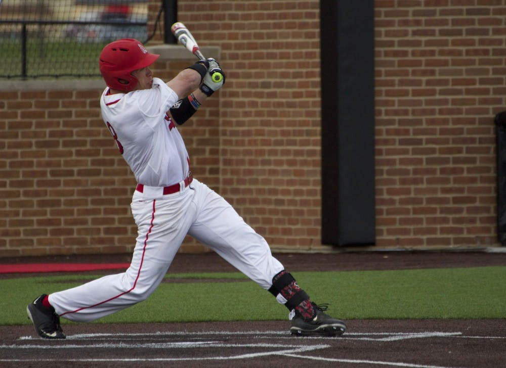 Alex Call, a junior outfielder for the Ball State Cardinals, attempts to hit the ball in the game against Ohio on April 1. DN PHOTO GRACE RAMEY