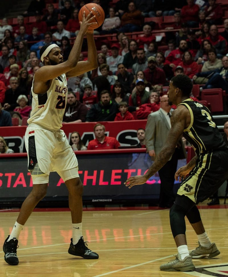 Redshirt Junior forward Tahjai Teague looks to pass the ball to a teammate Feb. 9, 2019, at John E. Worthen Arena. Ball State had 27 points on the board after the first half. Rebecca Slezak,DN