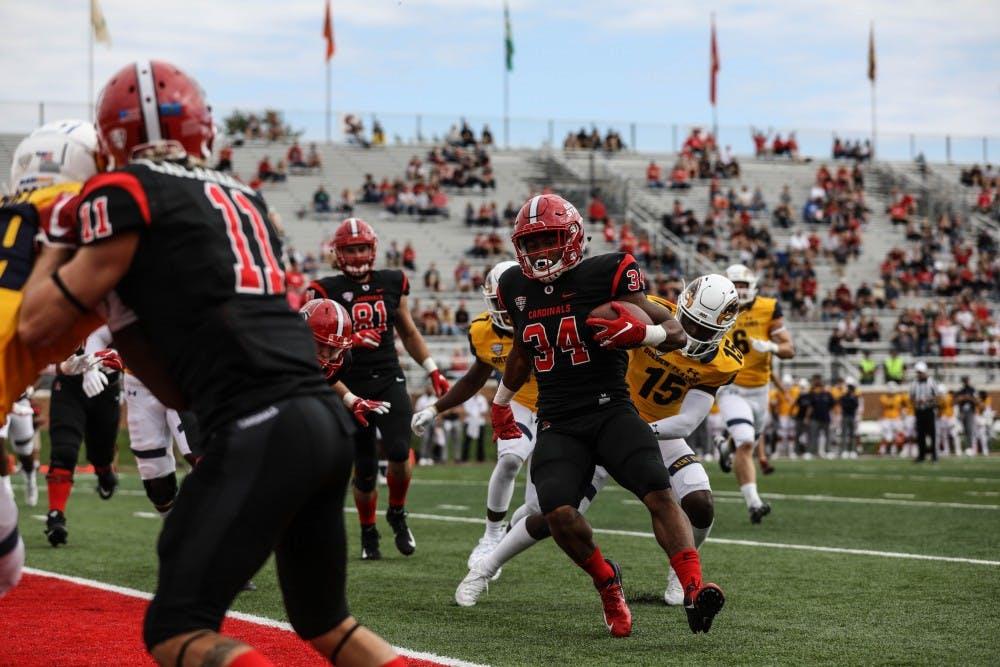 <p>Redshirt junior running back James Gilbert runs around Kent State players to score a touchdown Sept. 28, 2018, at Scheumann Stadium. Gilbert scored two touchdowns during the game. Rebecca Slezak,DN</p>