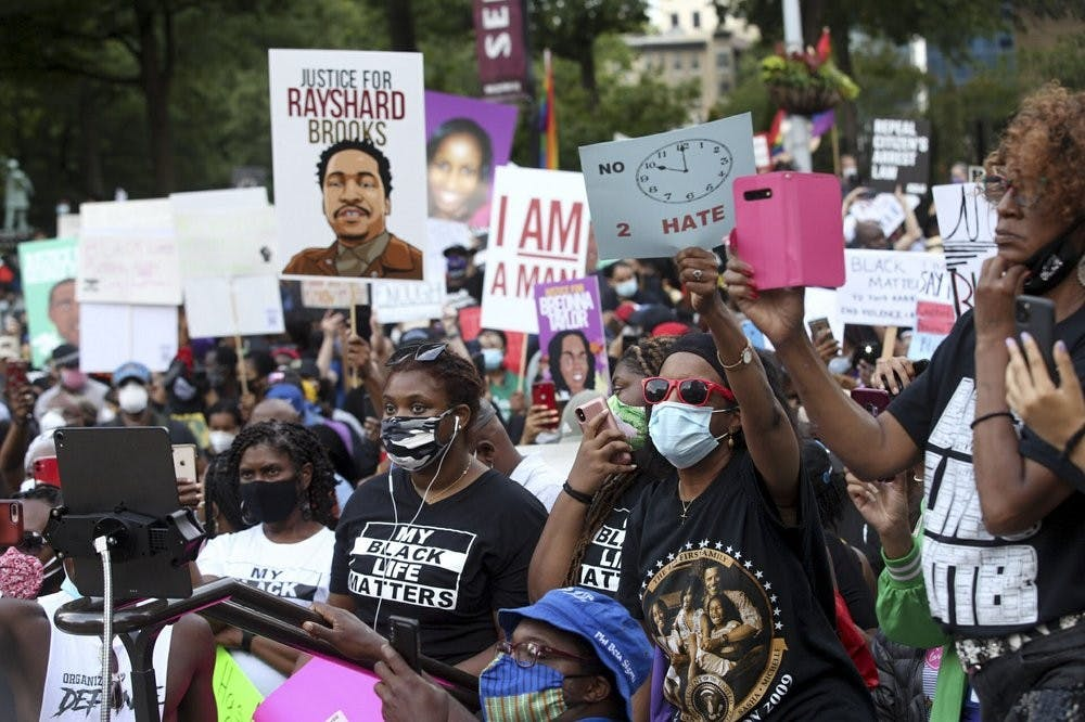 <p>A crowd of demonstrators march to the Capitol. The NAACP March to the Capitol coincided with the restart of the Georgia 2020 General Assembly Monday, June 15, 2020 in Atlanta. <strong>(Steve Schaefer/Atlanta Journal-Constitution via AP)</strong></p>