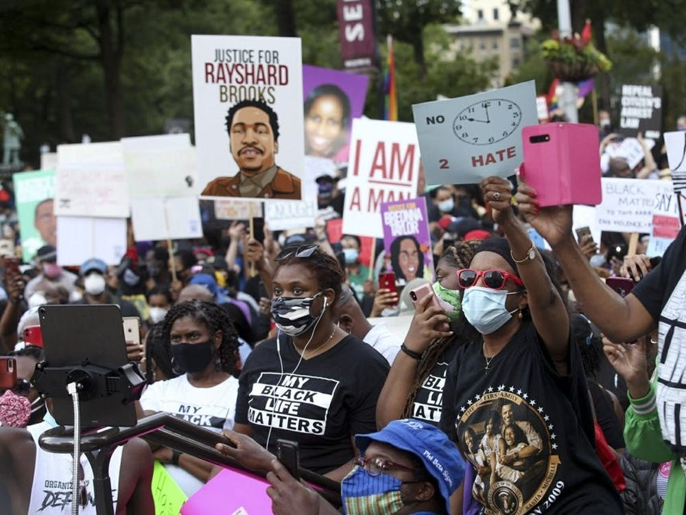 A crowd of demonstrators march to the Capitol. The NAACP March to the Capitol coincided with the restart of the Georgia 2020 General Assembly Monday, June 15, 2020 in Atlanta. (Steve Schaefer/Atlanta Journal-Constitution via AP)