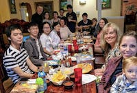 Students pose along with their host families at the student/host family dinner. Students from China and South Korea studying at Indiana Academy this fall will be staying with host families through the Foreign Links Around the Globe (FLAG) program. Robyn Whaley, Photo Provided