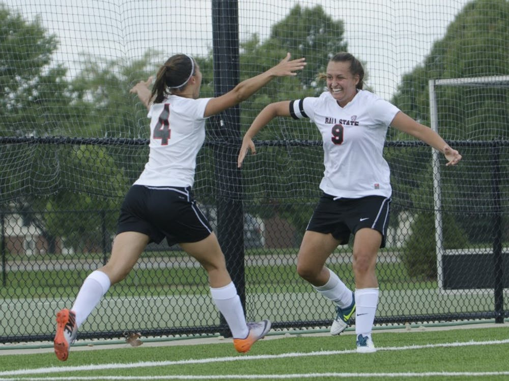 Sophomore midfielder Gabby Veldman and senior forward Nicole Pembleton celebrate after Pembleton scored a goal during the soccer game against Moorehead State on Aug. 31 at the Briner Sports Complex. DN PHOTO BREANNA DAUGHERTY