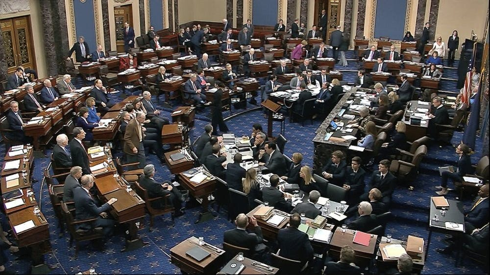 In this image from video, Senators cast their vote on the motion to allow additional witnesses and evidence to be allowed in the impeachment trial against President Donald Trump in the Senate at the U.S. Capitol in Washington, Friday, Jan. 31, 2020. The motion failed with a vote of 51-49. (Senate Television via AP)