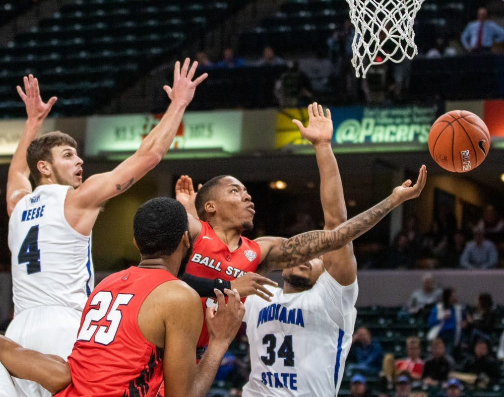 <p>Redshirt senior guard Josh Thompson shoots the ball in the paint Nov. 17, 2019, at Bankers Life Fieldhouse, Indianapolis, Ind. The Cardinals beat Indiana State 69-55. <strong>Jacob Musselman, DN</strong></p>