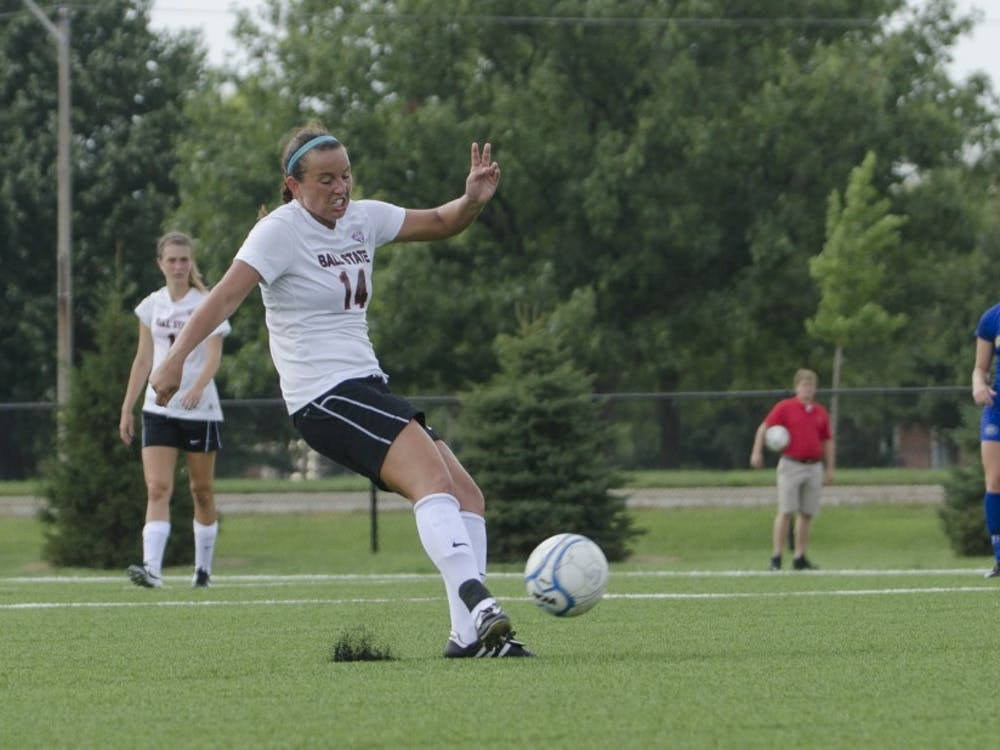 Senior midfielder Calley Starck kicks the ball during the soccer game against Moorehead State on Aug. 31 at the Briner Sports Complex. DN PHOTO BREANNA DAUGHERTY