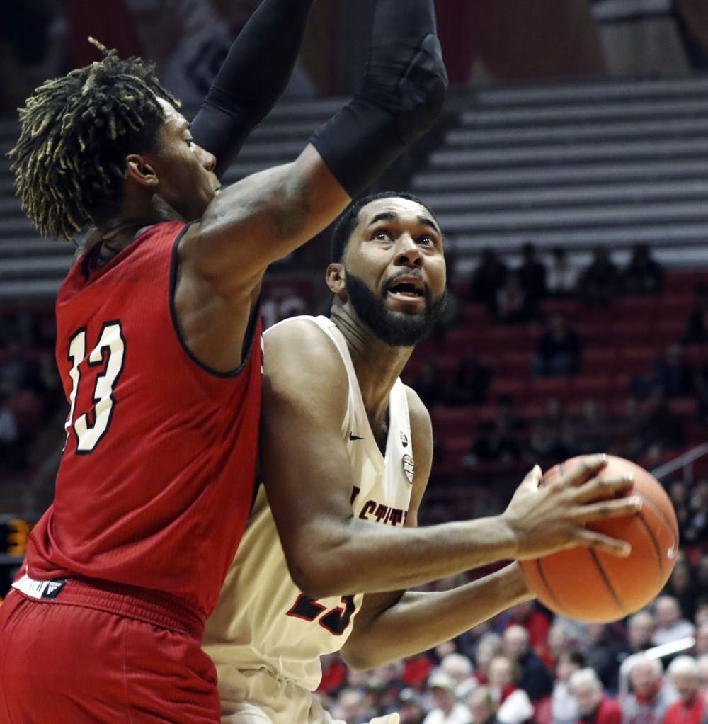 <p>Ball State junior forward Tahjai Teague goes for a layup while being guarded by Miami University sophomore forward Dalonte Brown during the Cardinals' game against the Redhawks Jan. 22, 2019 in John E. Worthen Arena. Teague scored 15 points. <strong>Paige Grider, DN</strong></p>