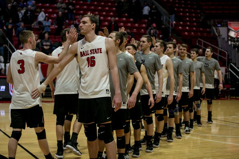 Ball State's mens volleyball team high fives after winning the game against McKendree April 6 in John E. Worthen Arena. The Cardinals won 3-0. Kaiti Sullivan, DN
