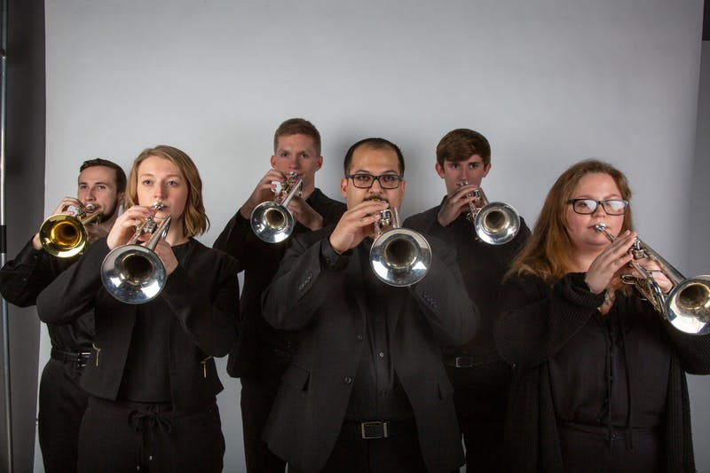 (Left to right) Kieran McNamara, Hannah Weibert, Grant Mason, Eric Rodriguez, Alec Shilling and Jenna Tribbett hold their trumpets in unison Feb. 17, 2020. Jaden Whiteman, DN