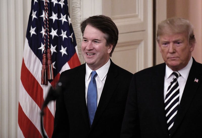 President Donald Trump, right, and Brett Kavanaugh, associate justice of the Supreme Court, arrive at a ceremonial swearing-in event in the East Room at the White House in Washington, D.C., on Monday, Oct. 8, 2018. Olivier Douliery/Abaca Press/TNS, PHOTO PROVIDED