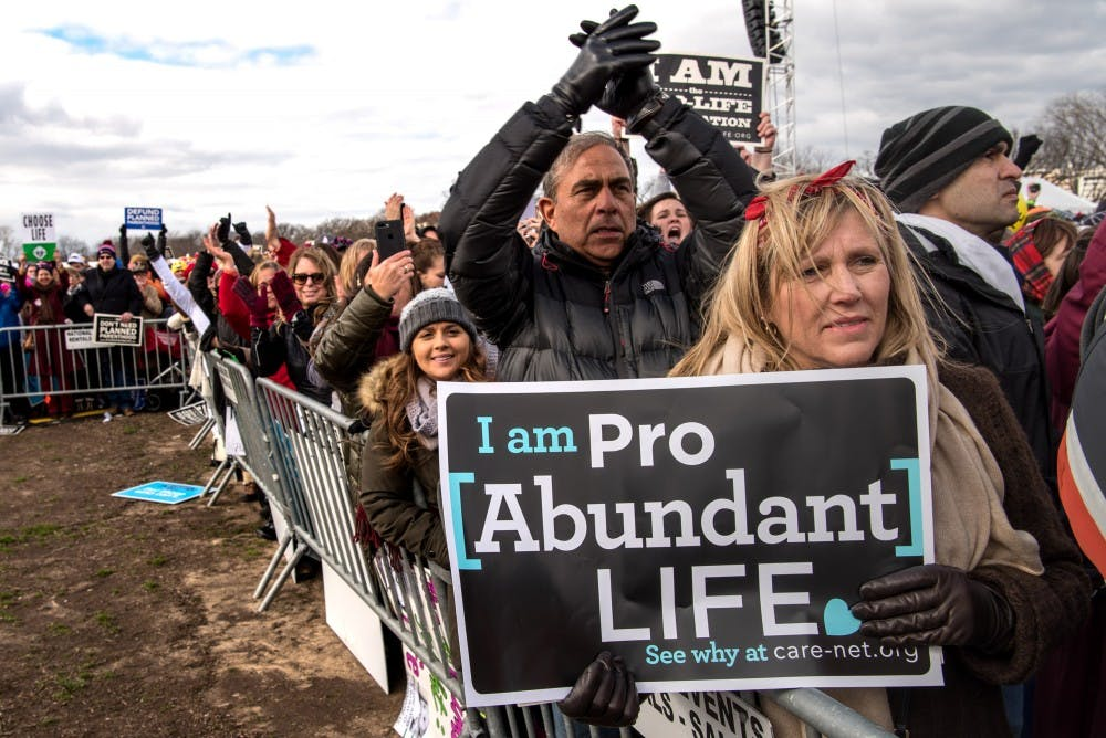 Mary Kolar, 58, from Tequesta, Fla., listens to Vice President Mike Pence as thousands of pro-life marchers crowd the streets near the National Mall during the March for Life Friday, Jan. 27, 2017 in Washington, D.C. (Ken Cedeno/McClatchy Washington Bureau/TNS)