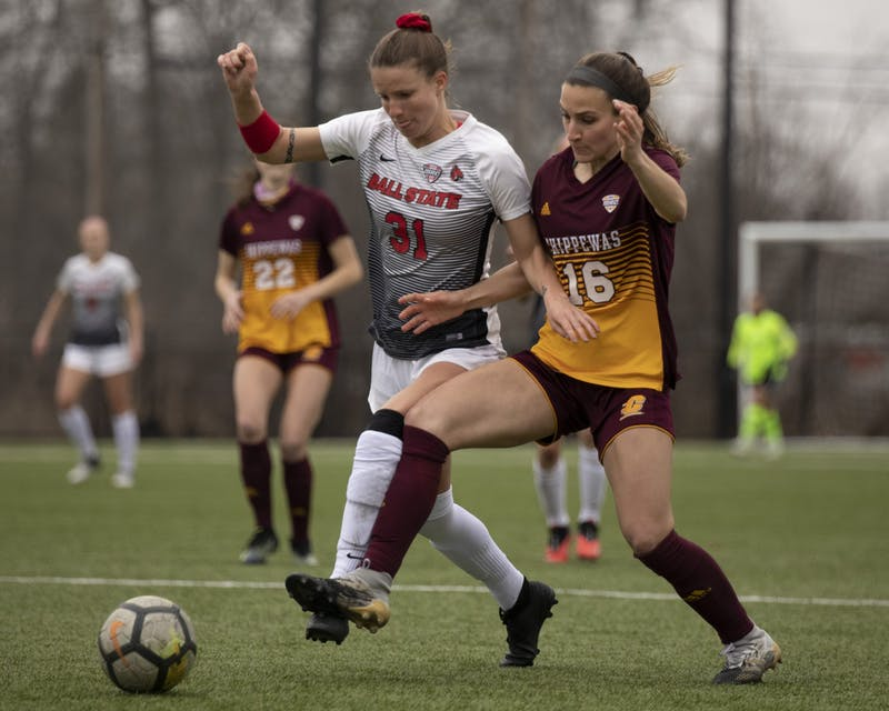 Cardinals junior midfielder Tatiana Mason and Chippewas senior defender battle for the ball March 26, 2021, at Briner Sports Complex. The Cardinals won 2-1 in overtime. Jacob Musselman, DN