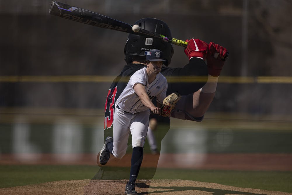<p>Bulldogs senior pitcher Jack Myers throws a pitch to Cardinals senior outfielder Ross Messina April 2, 2021, at Bulldog Park in Indianapolis, Indiana. The Cardinals beat the Bulldogs 7-2. <strong>Jacob Musselman, DN</strong></p>