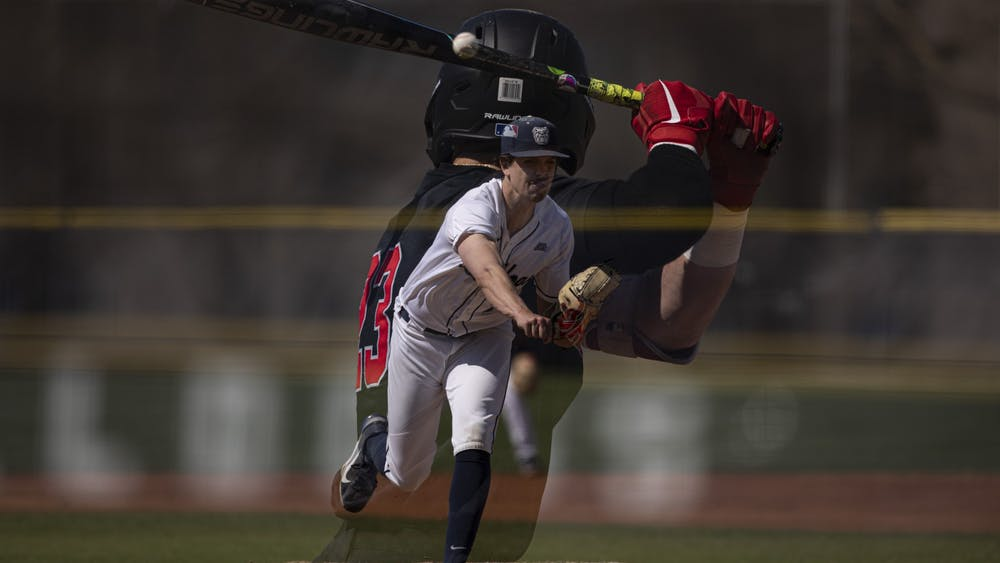 Bulldogs senior pitcher Jack Myers throws a pitch to Cardinals senior outfielder Ross Messina April 2, 2021, at Bulldog Park in Indianapolis, Indiana. The Cardinals beat the Bulldogs 7-2. Jacob Musselman, DN